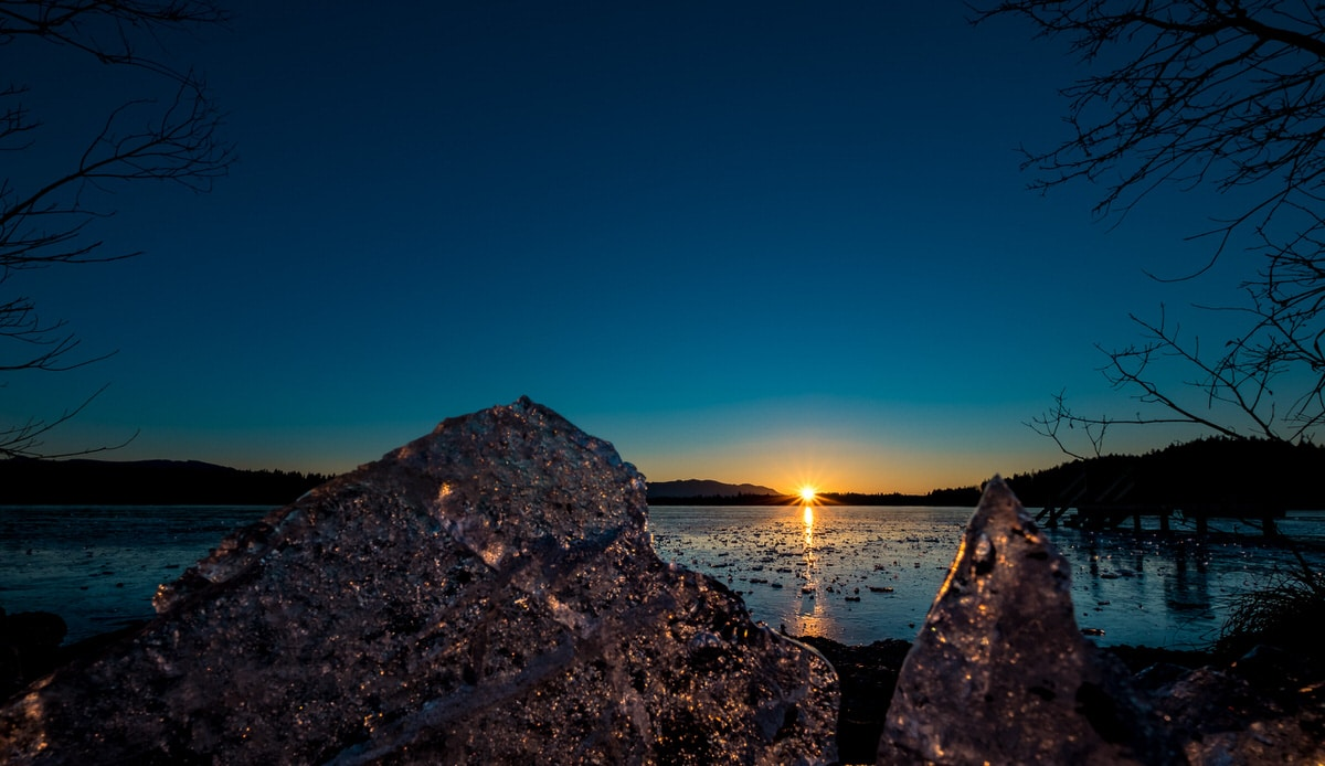 Sonnenuntergang am Kirchsee mit Blendensternen